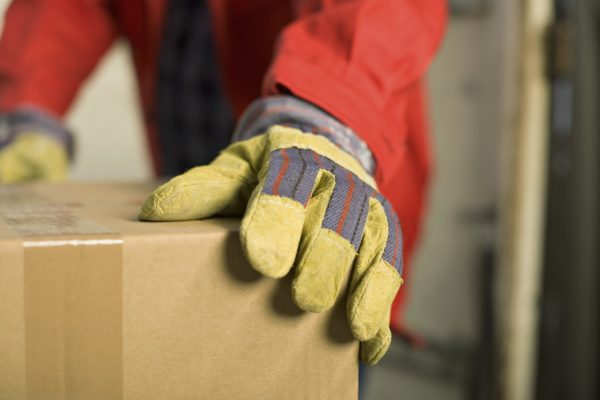 Closse up of worker's glove and box
